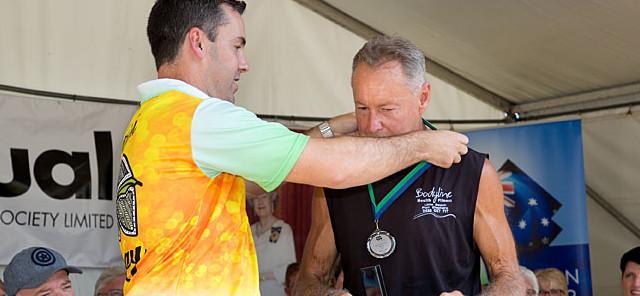 Lee Anlezark receive his award from Mayor Ryan Palmer