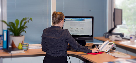 Woman standing at computer