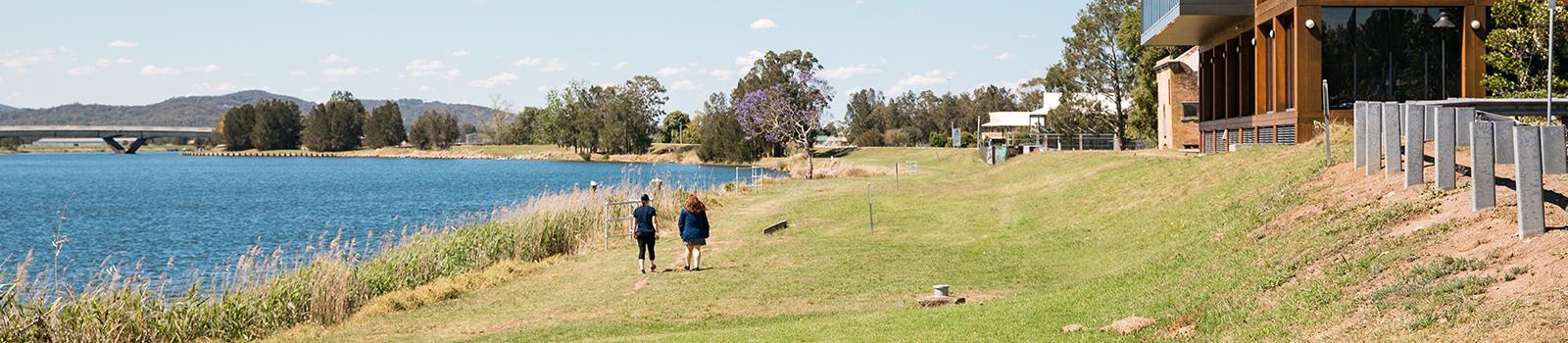 Image of walking along the river bank