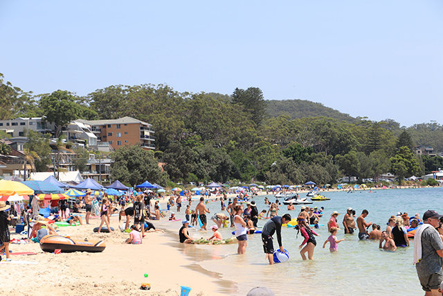Image of Nelson Bay beach filled with visitors