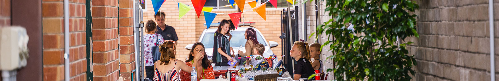 Young people celebrating Youth Week with markets in an alley