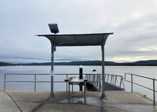 Fish cleaning table with new solar light overlooking the waters of Port Stephens