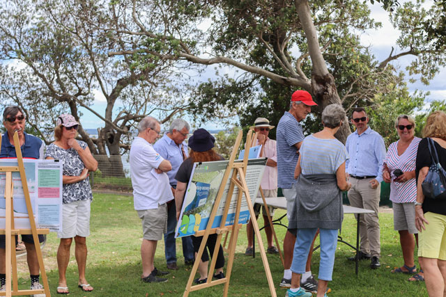 Community gathers around easels to have a say on projects in the park
