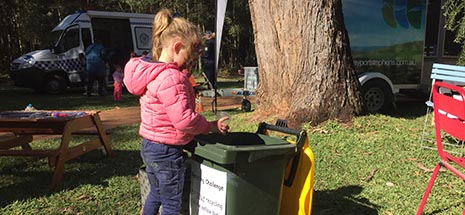 Image of girl putting litter in the bin