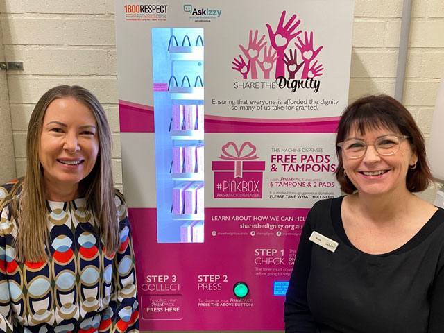 Library Services Manager Kris Abbott and Library Circulation Coordinator Nada with the Share the Dignity vending machine