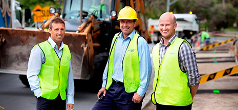 three men on construction site