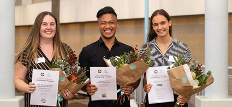 3 Mayoral Academic Scholarship recipients holding their certificates