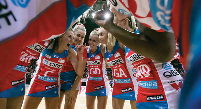 Image of Swifts captain Maddy Proud in a huddle with her team.