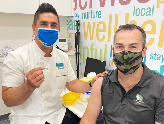 Pharmacist Christian Hernandez gives Mayor Ryan Palmer has his second dose of the COVID-19 vaccine