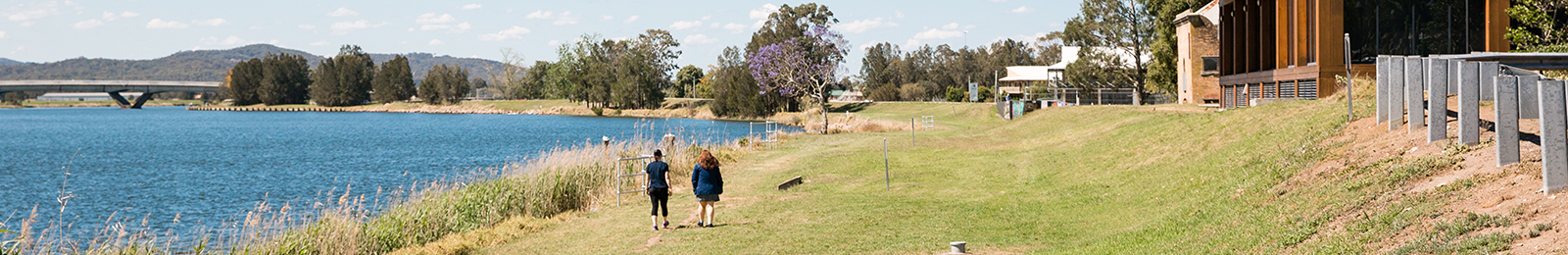 Image of women walking near river in Raymond Terrace