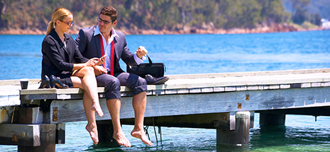 Business people barefoot on jetty