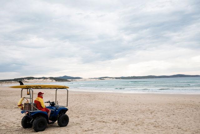 Lifeguard on bike at beach