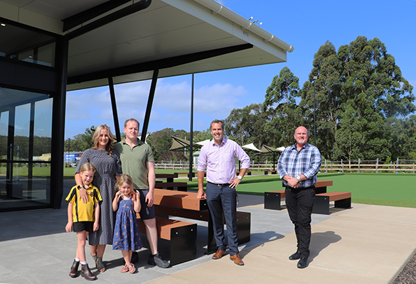 Medowie locals Charlie and Ben Way, with their two kids, stand with Port Stephens Mayor Ryan Palmer and Central Ward Councillor Chris Doohan in the outdoor dining area at Medowie Social.
