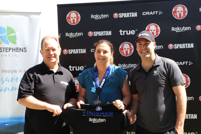 Pictured Chris Heverin, Managing Director Spartan Race Australia, Central Ward Councillor Sarah Smith and Port Stephens Mayor Ryan Palmer at the event launch in 2019