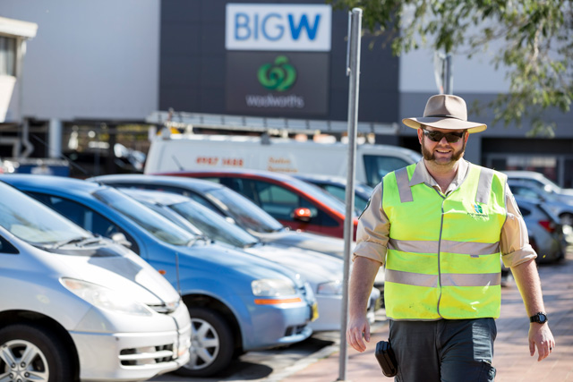 A Port Stephens Council ranger patrolling parking areas